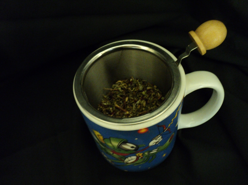 Put dried tea/herb mixture into cup